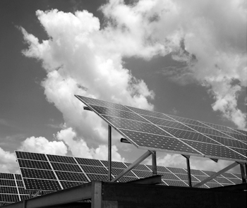 Black and white photo of solar panels.