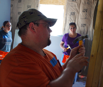 Volunteers working on a house building project.