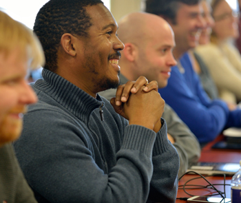Smiling african american man and diverse people listening to a lecture.